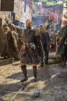 Stills from Outlander Episode 1×14 'The Search' Murtagh 'attempting' the Highlander Sword Dance which is much more difficult that it may look.