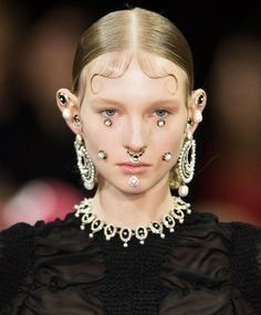 Trendy hairstyle for FW 2015: Chola gang hairstyle. Wet-look hair with baby hair slicked-down curls + flipped braids. Givenchy fall winter 2015.