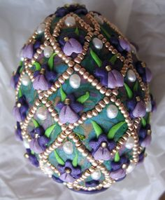 Aleta's  purple iris egg, decorated with polymer clay and beads.