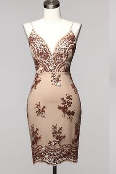 """Our """"Bay Bay"""" dress is glamorous and sexy yet classy. This dress is padded in the bust area and is runs small."""