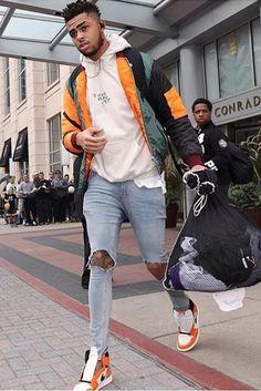 D'Angelo Russell wearing  I Ain't Dead Yet I Ain't Dead Yet Hoodie, Revedress Kayak Bomber, Saint Laurent Original Rip Skinny Jeans, Nike Air Jordan 1 Reverse Shattered Backboard