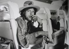 A photo of Mick Jagger, lead vocalist of The Rolling Stones on his way to Brazin in 1968, shot by Adger W. Cowans.