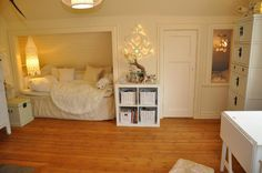 adorable kids room. Could use the nook for the changing table or crib first and change to seating space as they get older