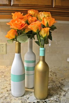 Wine Bottle Vases - I would do gold and a burgundy wine color for my dining room (Vanessa Nadia Moylan)