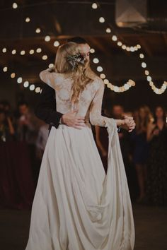 Industrial bohemian long sleeve lace and sheer panelling The Dress Theory gown and fresh flower up do | image by Nick Radford and Like a Letter