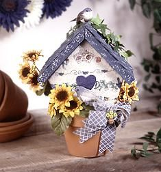 Clay pots are the perfect spring decor. Decorate your backyard with this great birdhouse. You need some garden print fabric, some floral ribbon and a few other materials. Once you make this the birds will be flying high.