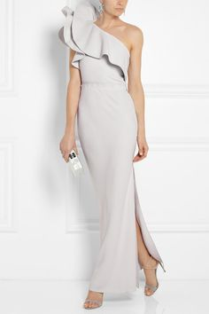 Lanvin Ruffled one-shoulder crepe gown -   Lanvin's dove-gray crepe gown is inspired by one of the designs in the label's Cruise '14 presentation. The asymmetric neckline is stiffened at the shoulder to ensure the ruffles retain their dramatic shape, and the waist is cinched with a signature grosgrain trim