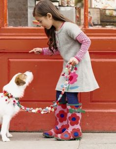 cute girlie, with some spice!  she's letting that doggie know what's up, yo! ps.  check that leash.  Note to self: make this when i get a dog!