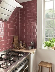 Creating a striking focal point, metro tiles as a splashback make a lovely design addition to a small kitchen and can be a great option if you're looking to inject colour into a space without it feeling overwhelmed. #kitchen #splashback #metrotiles #tiles #realhomes