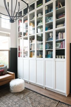 An entire wall of built in shelves with doors, and organized in ROYGBIV (rainbow) order! So fun to have kids toys mixed into it! Billy Bookcase Office, Ikea Billy Bookcase Hack, Bookcase Wall, Built In Bookcase, Billy Bookcases, Ikea Hemnes Bookcase, Ikea Billy Hack, Bookshelf Design, Wall Shelves