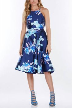Stay blooming in the spring with this fashion-forward floral printed midi dress in hues of blue and brushes of fuchsia pink.