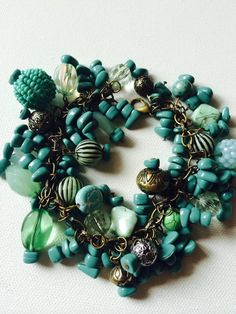 What a stunning bracelet!  Perfect for any occasion this bracelet features several different styles of turquoise, antique and green colored beads. All