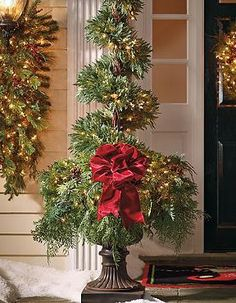 Flank your entry or walk with the beautiful Park Avenue Spiral Topiary that offer the perfect holiday touch that's sure to make a cheerful impression on the entire neighborhood.