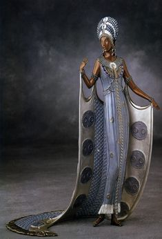 """""""Iras"""" bronze sculpture by Erté -The piece depicts Erte's costume design for Carmel Myers who played Iras, the vamp, in the 1925 MGM production of Ben Hur. The sculpture has a patina of light blue and white gold leaf. The design was based on a gouache created in 1925 for the movie."""