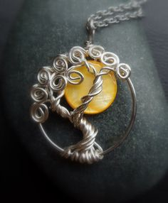Yellow Moon Mother of Pearl Sterling Silver Tree of Life Necklace. $48.00, via Etsy. I absolutely LOVE this neckles and I must have one. :)