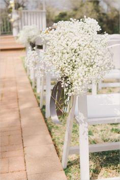 babys breath hanging from chairs at ceremony #outdoorwedding #babysbreath #weddingchicks http://bit.ly/1f2b9ef