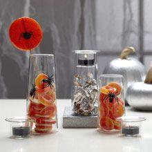 Halloween Centerpiece decoration ideas, spiders, orange, glass, black candles, candy