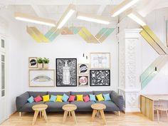 Sofa with colorful pillows and wall graphics