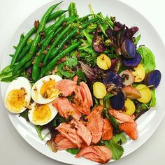 Niçoise Salad With Salmon, Green Beans And Purple Potatoes. Get this and 40+ more Salmon recipes at https://feedfeed.info/salmon