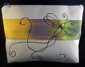 11 inch pouch. Free machine embroidered design
