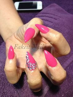 Stiletto acrylic nails with pink nail polish & diamond feature nails by Fakeit Nails & Beauty!