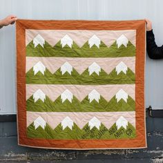 The mountains are calling and I must go! I'm finding so much solace in nature lately and the Snowy Mtn quilt is a great way to celebrate that! It comes with a bonus SVG design for cutting machines. Have you ever added iron-on vinyl to a quilt? It's a fun extra touch to personalize your quilt! Get it at PatternoftheMonthClub.com! | Fabric: Riley Blake Designs Confetti Cotton