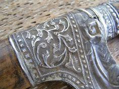 Sale > Weapons > TUMBUK LADA BADIK RIAU Antique Weapon Knife Dagger Sword STERLING SILVER SHEATH WE0644 An antique Tumbuk Lada, scabbard and hilt made from quality wood and decorated with silver. A traditional Malay weapon from Riau, similar to a badik but usually much more elaborated. Total: 39 cm / 15.4 inches Blade only: 26.5 cm / 10.4 inches Scabbard / casing: 32 cm / 12.6 inches Weight: 0.25 kg / 0.55 lb Pada pangkal sarung Tumbuk Lada terdapat bonjolan bundar yang selalunya dihias…