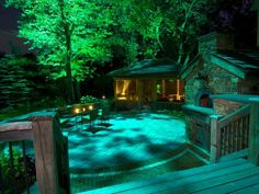 22 Landscape Lighting Ideas: Seating areas benefit from moon lighting or lighting installed high overhead because there are no harsh bulbs at eye level and it creates a cozy, intimate feel. No one likes to feel as if theyre on stage when theyre sitting outside, says MacMorris.  From DIYnetwork.com