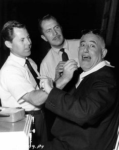 """Makeup artist Monty Westmore, Vincent Price and director William Castle on the set of """"The Tingler"""", 1959."""
