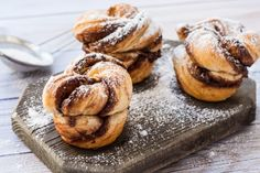 Ingredients8 oz refrigerated crescent dough SAVE $ 1/2 cup hazelnut cream 1/2 cup chopped hazelnuts 3 tbsp powdered sugar  MethodGrease a muffin tin. Roll the dough into two rectangles.