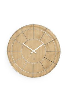 "Decorative time piece Quieter continuous movement Wooden clock with a metal cage over the face Includes a sweeping, continuous movement mechanism Mounts via saw tooth hanger    Dimensions: 16"" dia.. x 5"" (41.3 cm dia.. x 12.7 cm)   Cage Wall Clock by Umbra. Home & Gifts Canada"