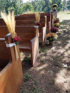 Pews with wheat spray with flowers and ribbon with mums down the side