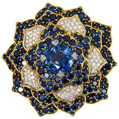 Verdura Gorgeous Sapphire Diamond Gold Flower Brooch | From a unique collection of vintage brooches at https://www.1stdibs.com/jewelry/brooches/brooches/