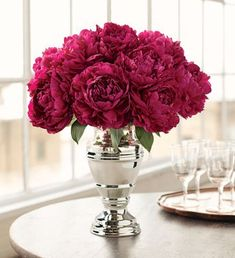 Burgundy peony centerpieces for a winter wedding with a burgundy and silver theme! Simple and stunning!