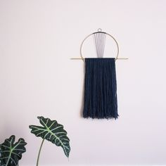 Sunrise circle with horizontal fringe wall hanging