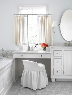 Chic Bathroom With Marble Top Drop Down Make Up Vanity Under Window Covered  In Linen Cafe Curtains Paired With White Slipcovered Vanity Stool.