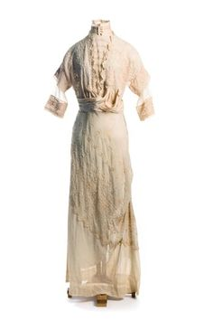 Embroidered gauze dress, c. 1912    Covered with floral embroidery, the dress shows interesting drapery, perhaps inspired by designer Poiret in the early 1910s. Kate F. Cleary (1860-1948) of Charleston wore this stylish garment. It was given to the Museum by her great-nieces.
