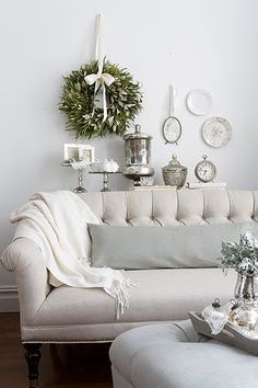 A simple Christmas wreath becomes the focal point in a neutral living room.