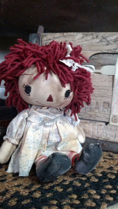 Raggedy Ann waiting for her sand bucket.