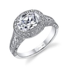 Unusual east-west halo setting for an oval center diamond - Sylvie Vintage Collection engagement ring