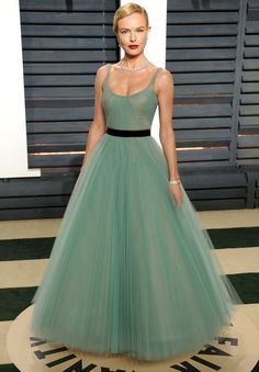KATE BOSWORTH wears a sage green J. Mendel gown with a black belt and a full tulle skirt, plus Piaget gems to the Vanity Fair after party.