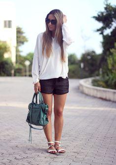 Simple ensemble of dark shorts and crisp white, loose fitting blouse!