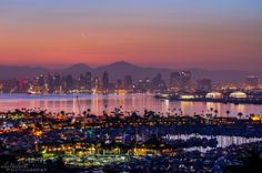 Alex Baltov Photography in San Diego, CA   -    Crescent moon over the city at dawn this morning  3.29.14