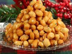 Growing up in an Italian family in New York it wouldn't be Christmas without Struffoli. They are small honey balls that are fried and so yummy. Perfect for the holidays.