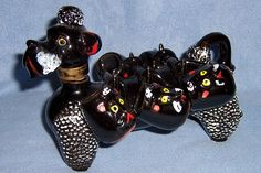 Black poodle decanter with cups.