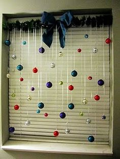great idea, tension rod, ribbon, christmas bulbs and some greenery, cute window treatment.  Might try this in my office windows.