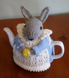 Free Knitting Pattern for Mrs. Bunny Rabbit Tea Cozy - The tea cozy will fit a medium teapot and is knit flat in worsted yarn and seamed. Designed by J. J. Waugh