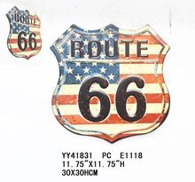 Vintage embossed metal US route 66 sign
