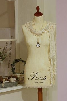 cute dressmaker form for displaying necklaces