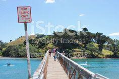 Pataua Footbridge, Whangarei District, Northland, New Zealand royalty-free stock photo Image Now, New Image, Pedestrian, Celebrity Photos, New Zealand, Royalty Free Stock Photos, Celebrities, Beach, Water